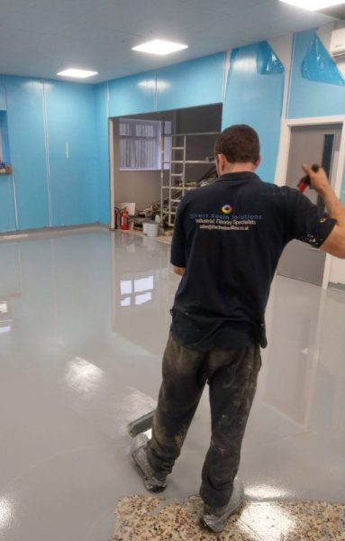 Resin floor being out down by staff